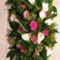 Langwerpig bloemstuk oud roze